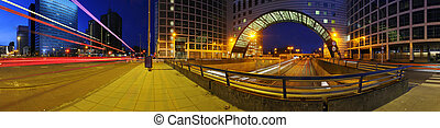 a 360 degrees panoramic image of a roundabout on top of a motorway. A big downtown junction