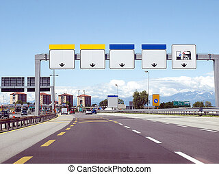 Perspective view from car on a motorway approaching a toll booth