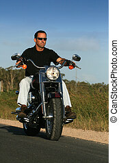 Motrocycle rider 4 - A man cruises on a classic style ...