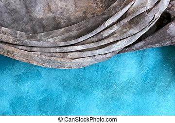 mottled backdrop cloths - a grey mottled backdrop is draped...