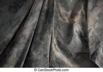 mottled draped background cloth - A grey mottled...