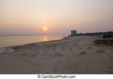 Mounds of beach sand on Rio Negro