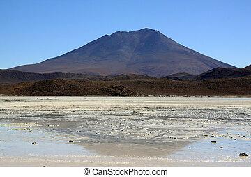 Mount and salt lake near Uyuni in Bolivia