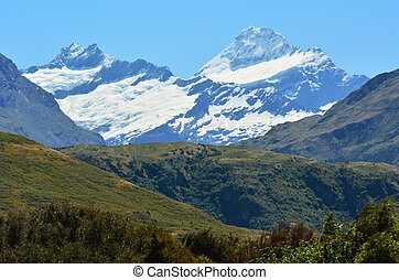Mount Aspiring (R) in the Otago region of the South Island of New Zealand.