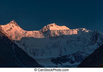 Mount Beluha at sunset. Altai Mountain. High quality photo