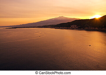 Mount Etna by the sea from Taormina at sunset