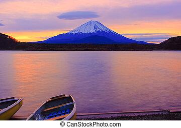 Mount Fuji and boats at sunrise