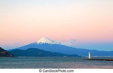 Mount Fuji and the light house seen from the beach