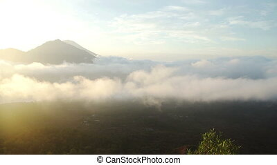 Mount in jungle and clouds around volcano Batur Bali -...