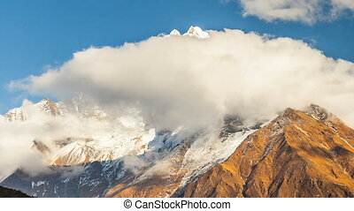 Mount Kangtega and moving clouds. Track to the base camp of Everest in the Himalayas. Sagarmatha National Park, Nepal