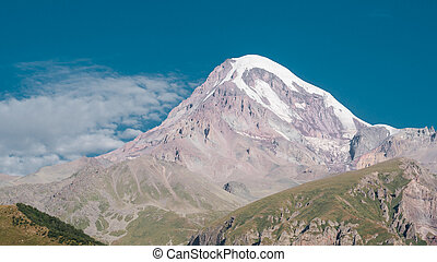 Mount Kazbek with view from Stepantsminda town in Georgia.