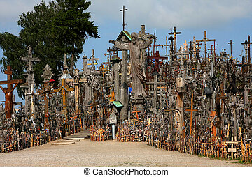 Many large and small crosses on the hill in Lithuania