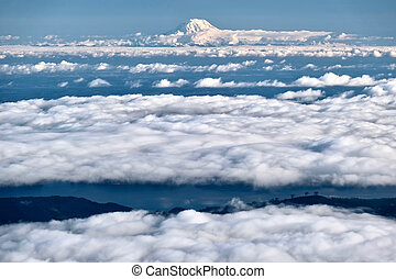 Mount Rainier in clouds and Seattle.