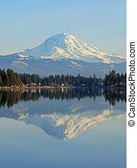 Mount Rainier reflecting in lake Tapps in Sumner Washington