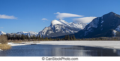 Mount Rundle , Banff - Mount Rundle reflected in the icy...