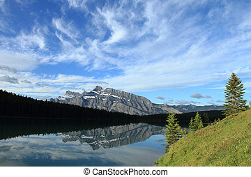 Mount Rundle reflected in Two Jack Lake - Morning light on...