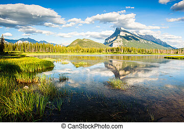 Mount Rundle with blue sky reflecting in Vermilion Lakes -...