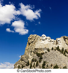 Mount Rushmore. - Mount Rushmore National Memorial with blue...