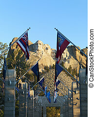Mount Rushmore National Memorial as seen from entrance with state flags.