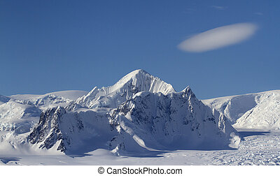 Mount Shackleton and clouds above it in a blue bright sky on...
