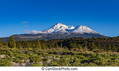 Mount Shasta in northern California with a cloud and a blue ...