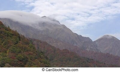 Cloud streams hangs over the mount Tanigawa in autumn