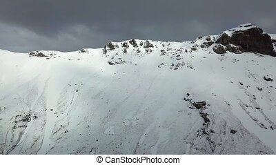 Mountain aerial drone shot in Iceland, snow on the mountains