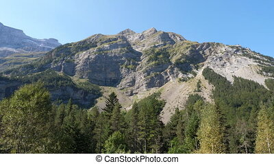 Mountain and cliff face. Approaching Cirque de Gavarnie, Pyrenees, France.
