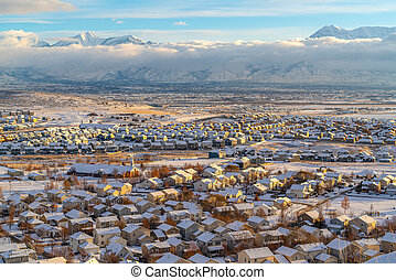 Mountain and homes on a white landscape of snowy neighborhood in winter