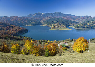 mountain and lake in autumn
