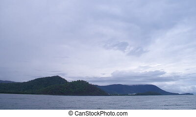 Mountain and ocean and Sky - A wide shot of the mountains...