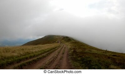 First person view of mountain ascending along ground road to point of interest (pov)