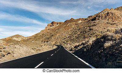Mountain asphalt road in the mountains. Asphalt in the mountains is black. Beautiful road in the mountains.