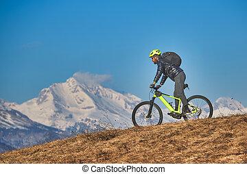Mountain bike excursion in the mountains on the meadows