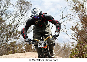 Mountain Bike - extreme mountain biker riding on large rocks