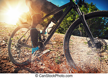 Mountain bike on ground - Cycling on land with stones and ...