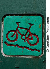 Mountain bike red sign on a green post