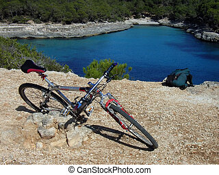 Resting mountain bike near the coast in summer in Majorca (Balearic Islands - Spain)
