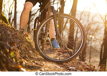 Mountain biker - Closeup of cyclist man legs riding mountain...