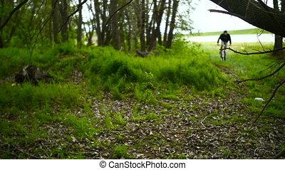 Mountain Biker Ride on Cross-Country