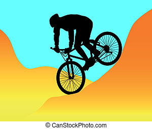 mountain biker riding in the mountains - silhouette of a...