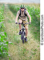 Mountain biker riding on bicycle