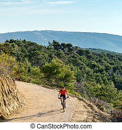 Mountain biker riding on bike at the sea