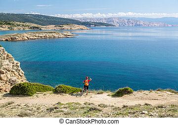 Mountain biker riding on bike on rocky trail