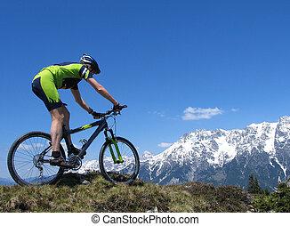 Mountain biker riding through the mountains in the European...