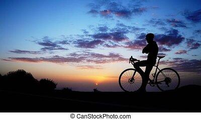 mountain biker silhouette in sunrise.