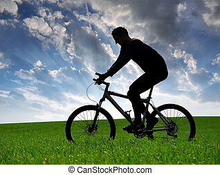 mountain biker silhouette in sunset