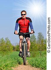 mountain biker in spring landscape