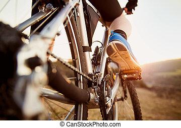 Mountain biker - Detail of cyclist man feet riding mountain...