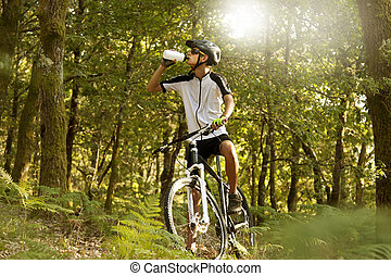 mountain biker with bike